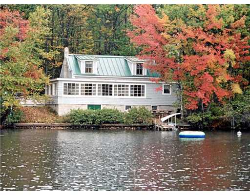 your jones orneville in dewitt realty camps lakefront maine realtor sale big for of cozy twp on shores water town cottages boyd lake the home with frontage waterfront cottage